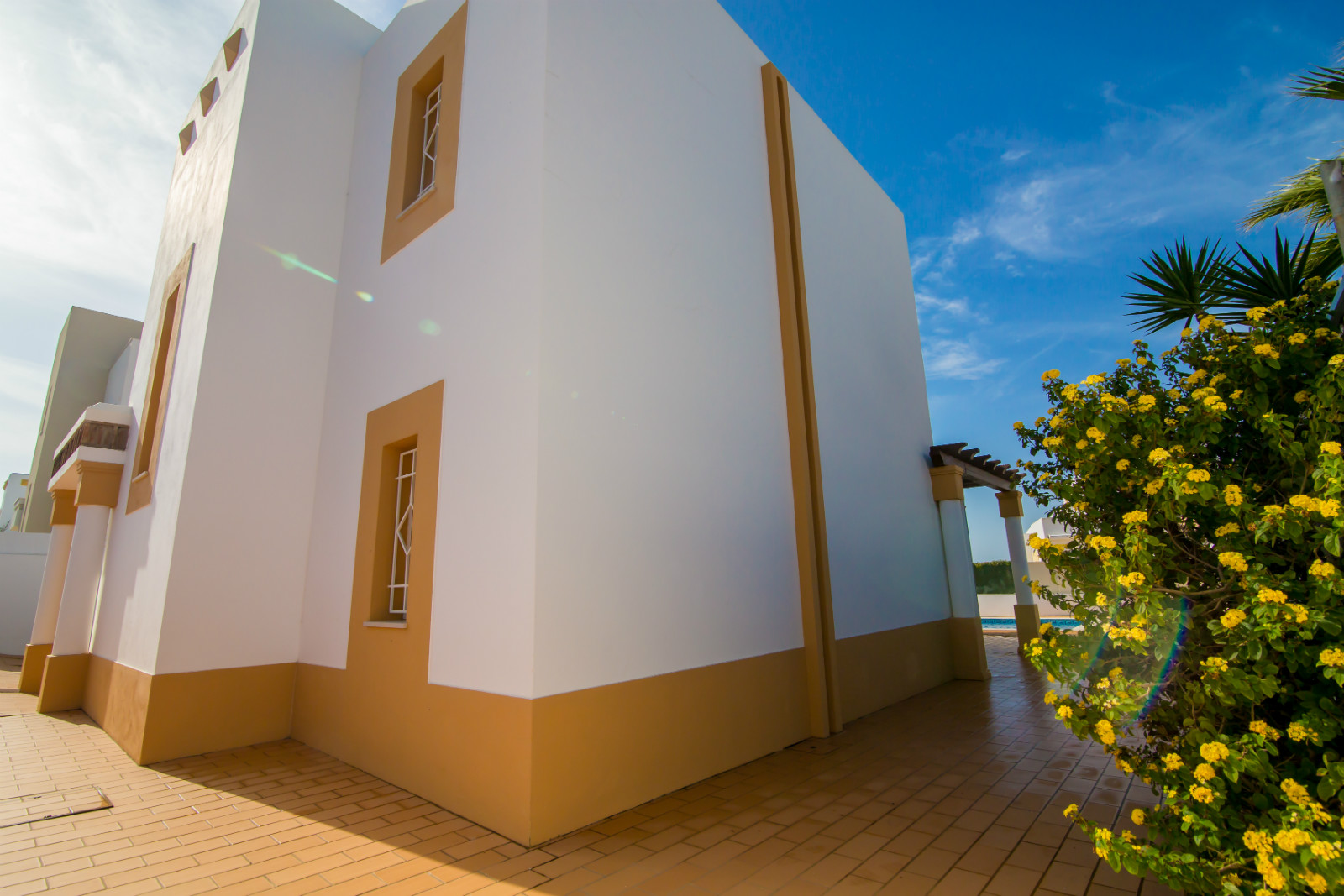 The beautiful villa has lots all round, outdoor spaces. Great for children.