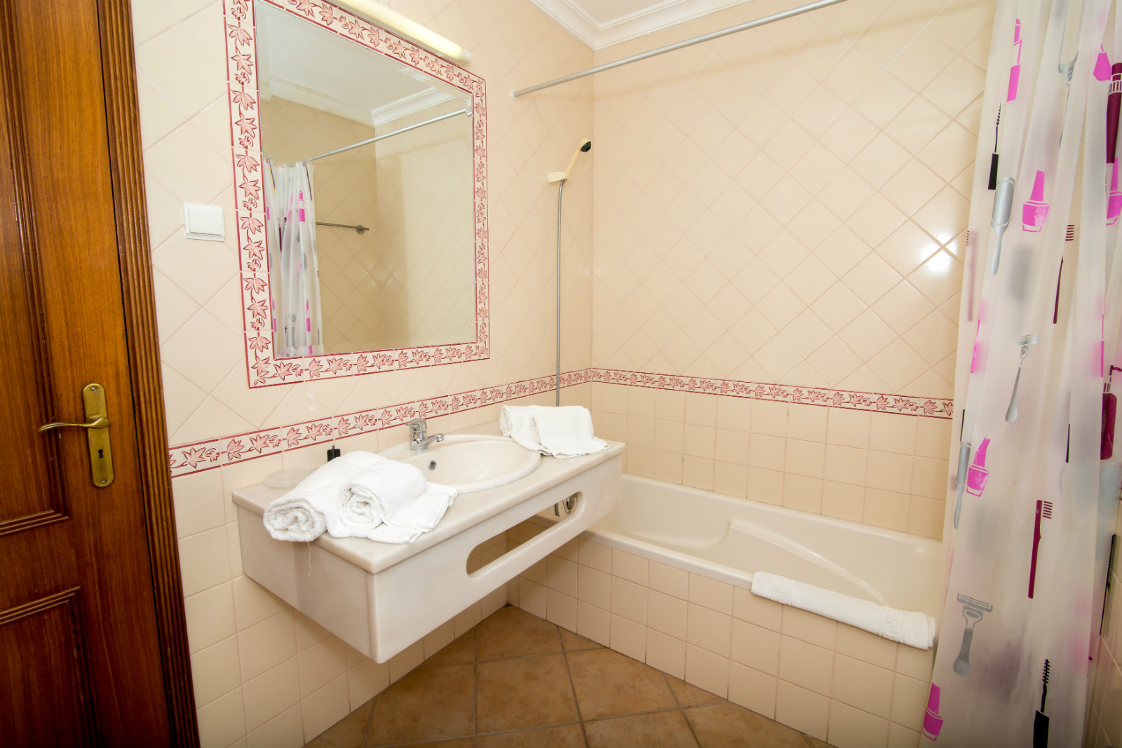 1st floor, beautiful, full bathroom with tile flooring and marble basin.