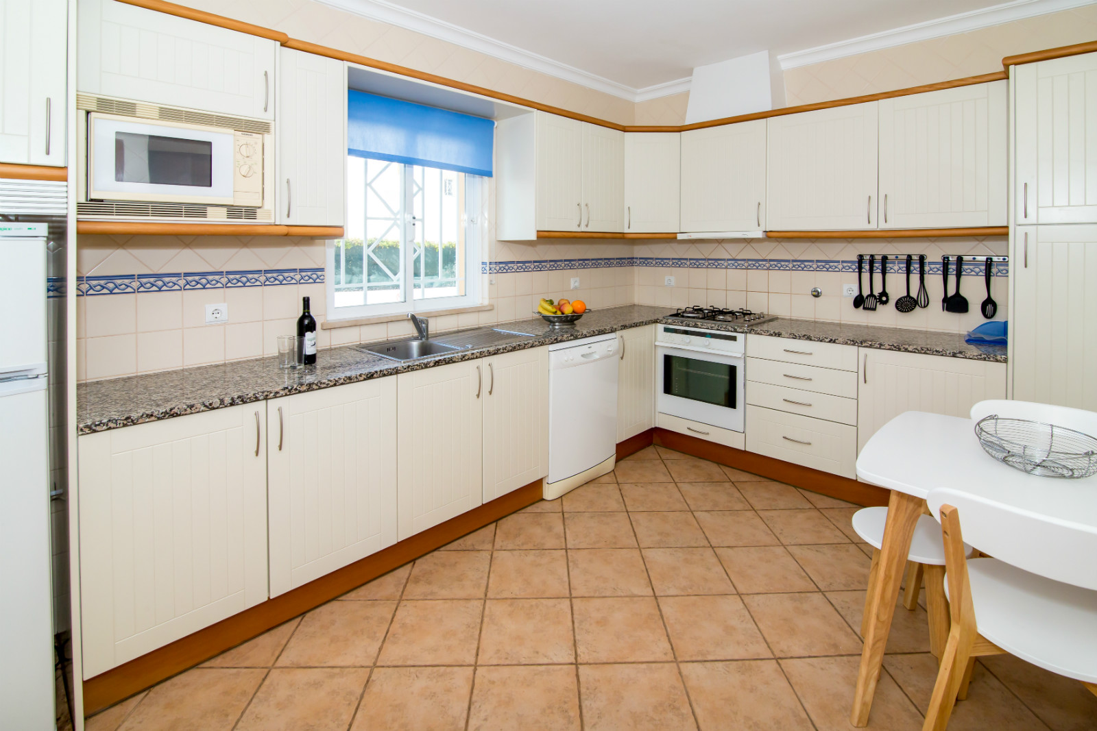 Spacious, light and bright magnificent, fully equipped kitchen overlooking pool.
