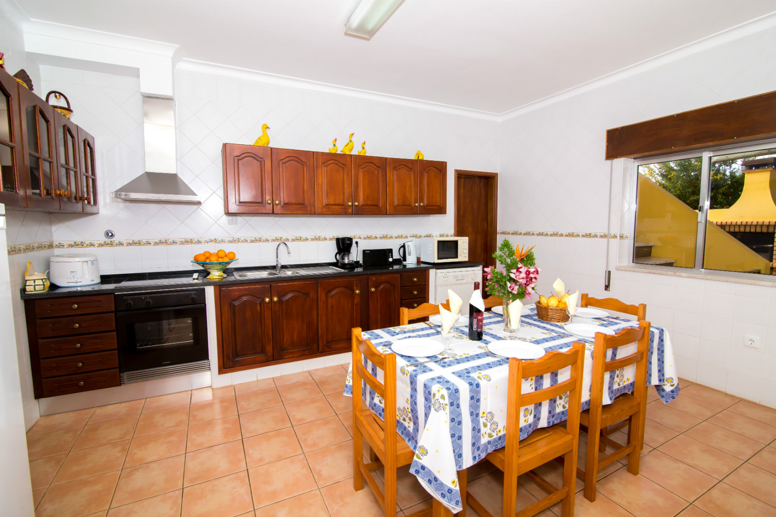 Fully equipped, spacious kitchen with door to outside BBQ & table & chairs.