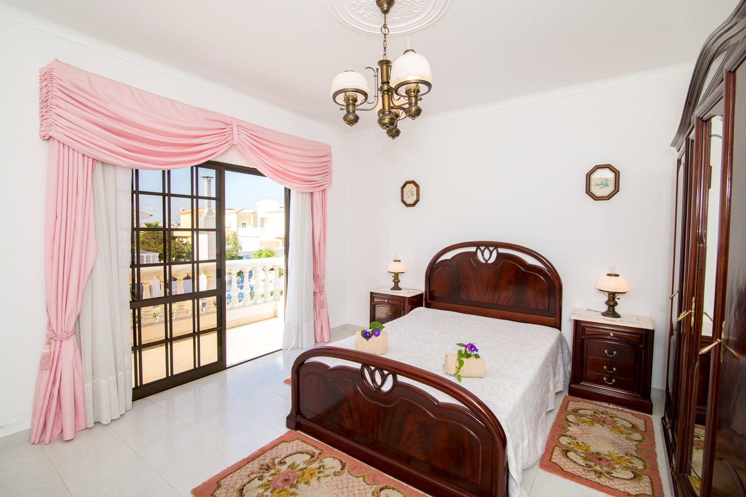 2nd floor double bedroom also with terrace with picturesque resort & sea views.