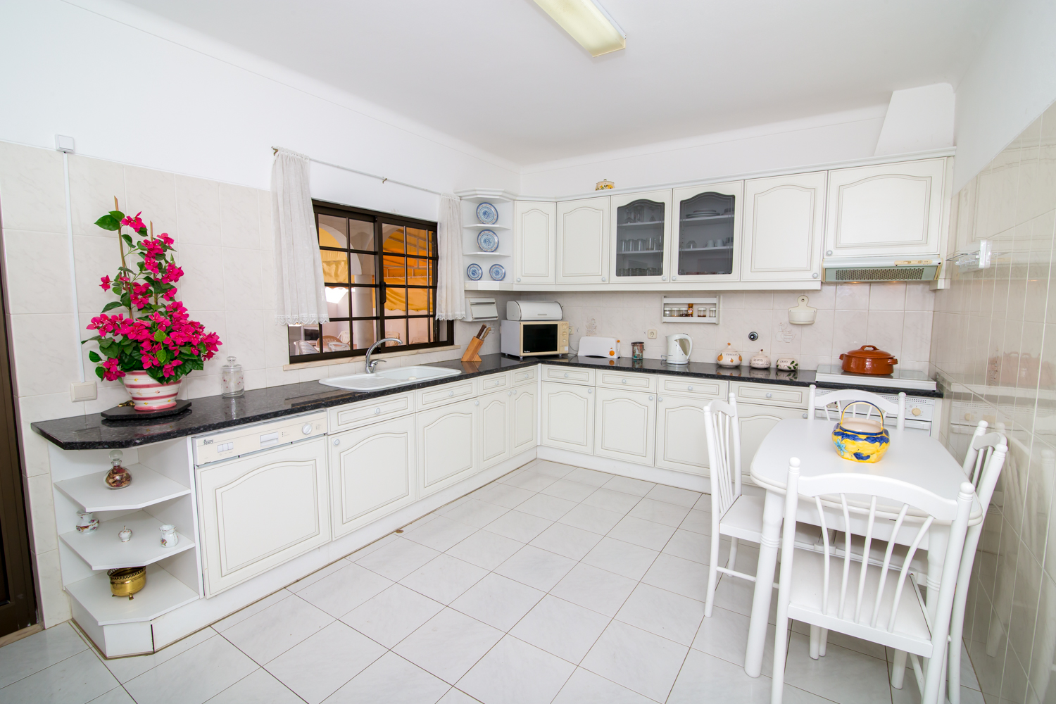 Fabulous, spacious, fully equipped kitchen overlooking pool and terrace.