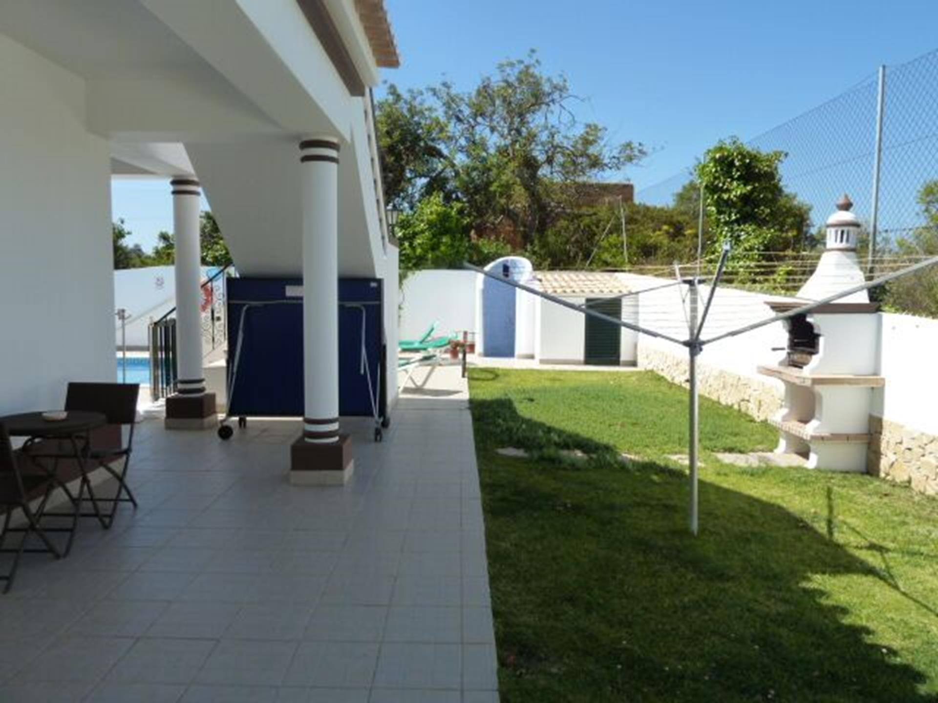Outdoor BBQ, located by the pool, including outdoor shower & ping pong table.