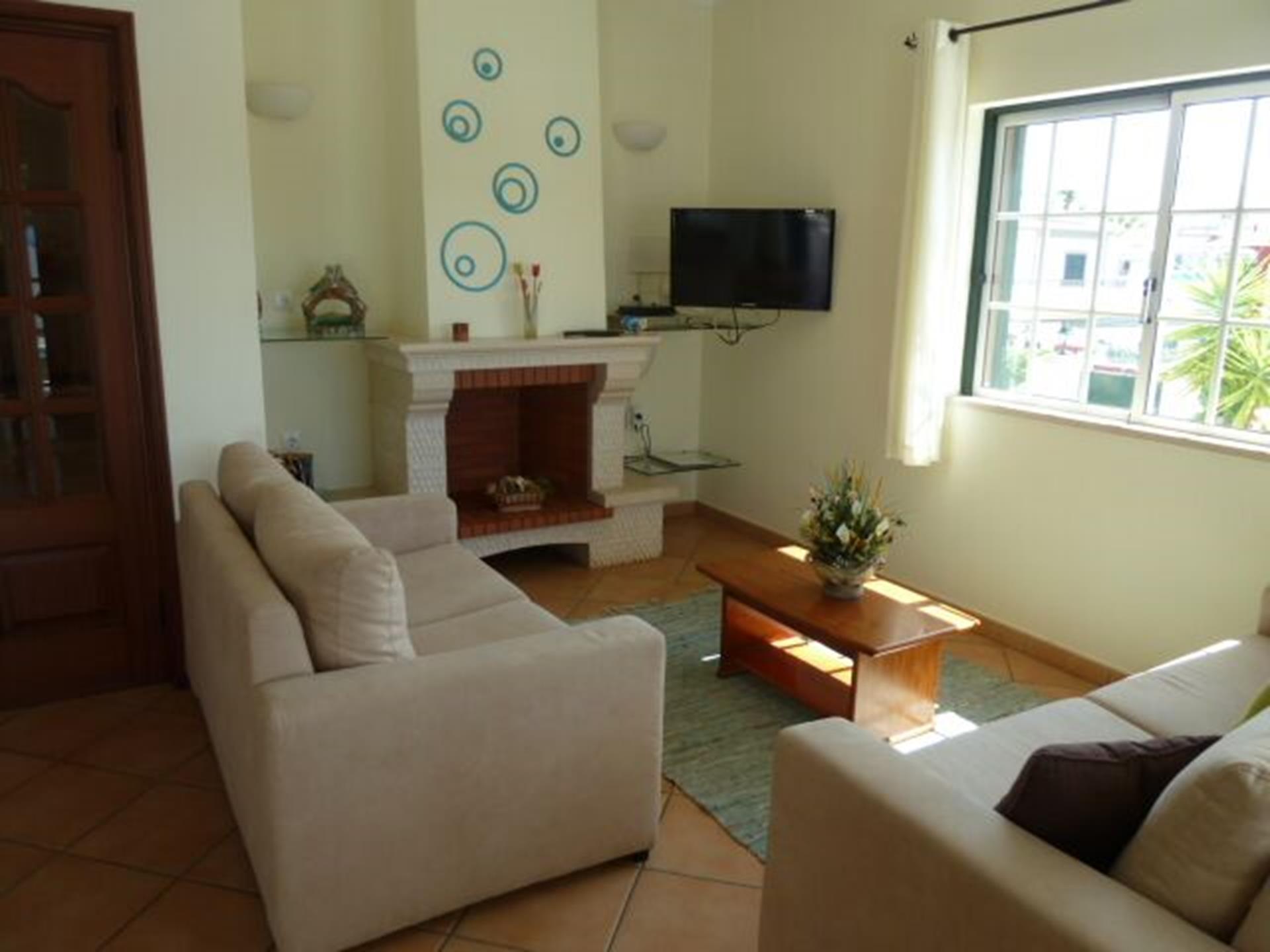 Open plan lounge/dinner, overlooks pool, villa entrance, dining room & kitchen.