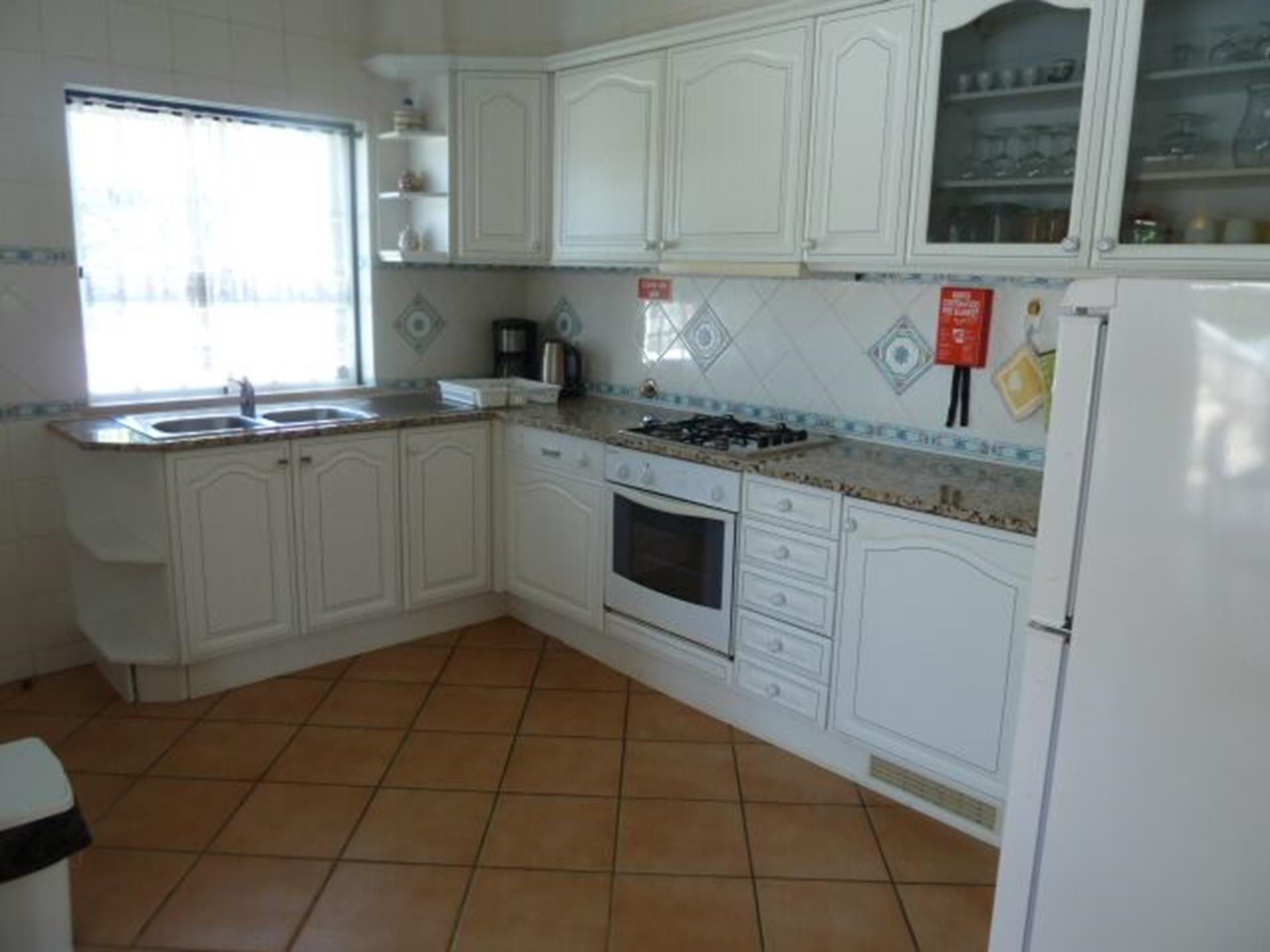 Fully equipped, open plan light & bright kitchen with window, overlooking pool.