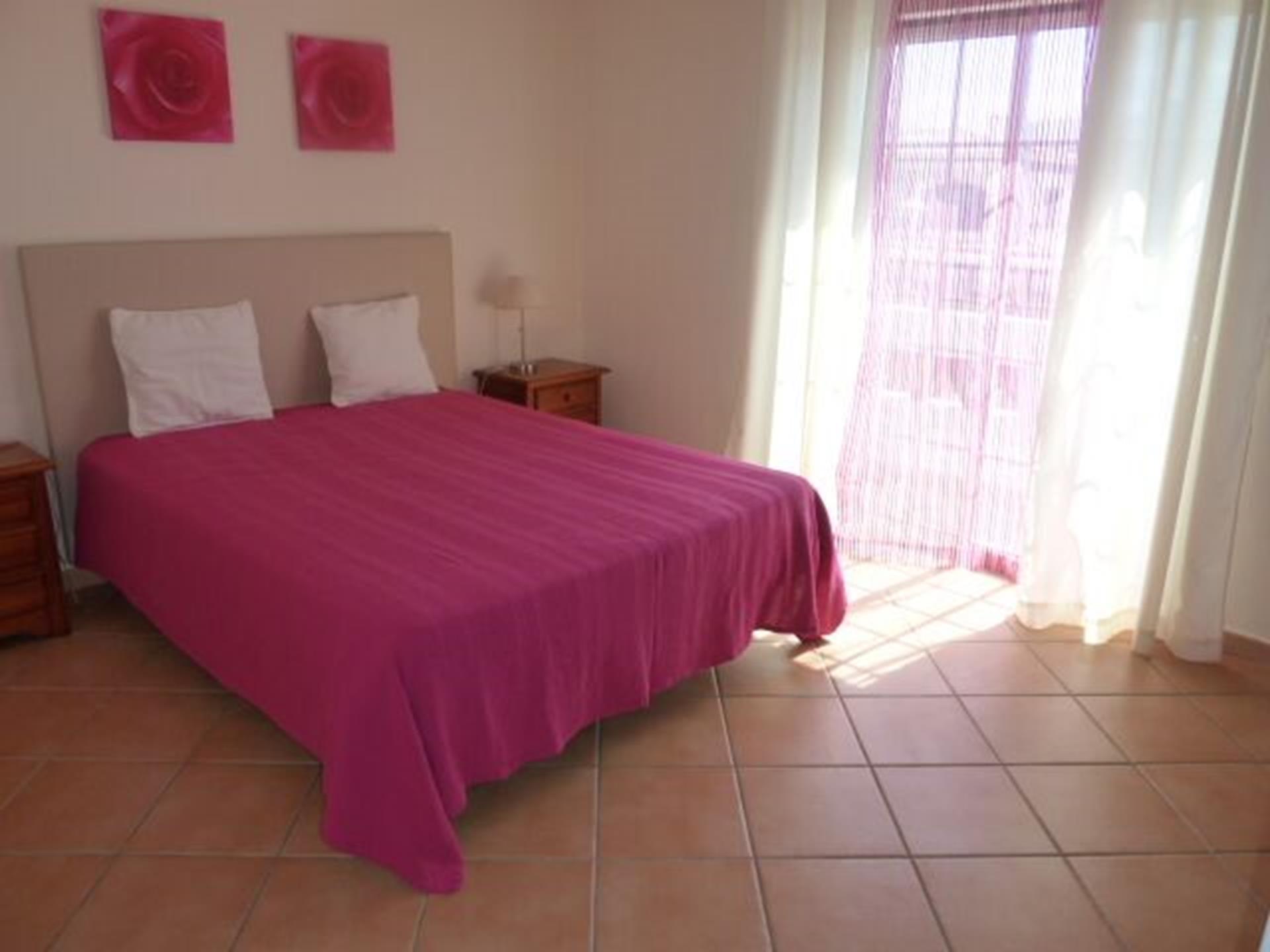 A/C Purple bedroom with a balcony, overlooking entrance villa gardens & pool.