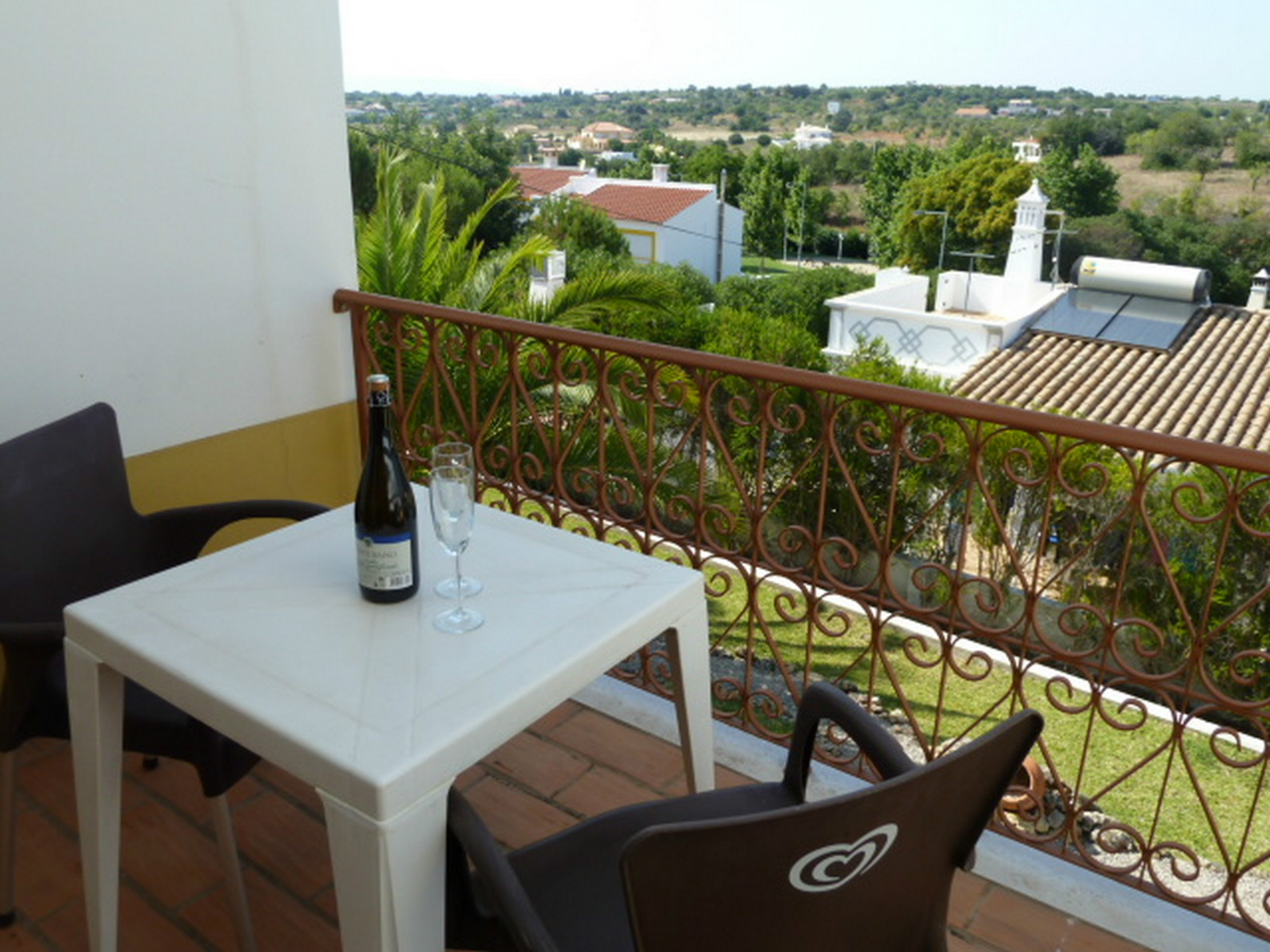 Relaxing & cool, rear garden terrace enjoys great views of villas & countryside.