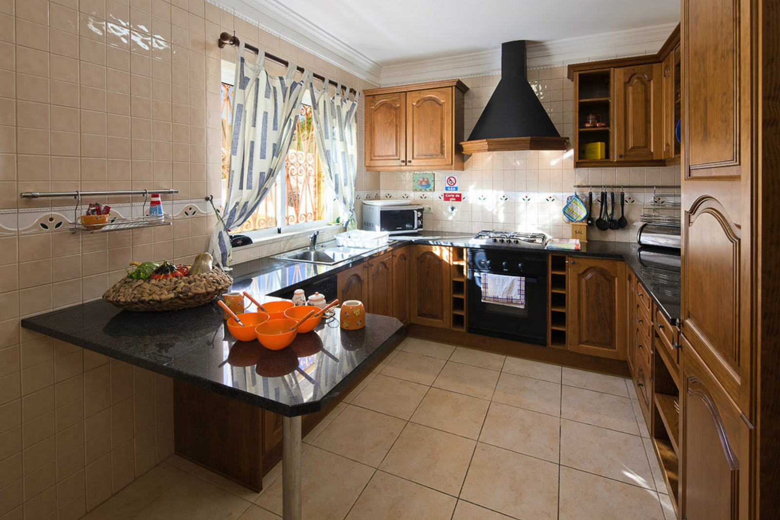Beautiful, fully equipped kitchen, table & chairs, window & door to pool terrace