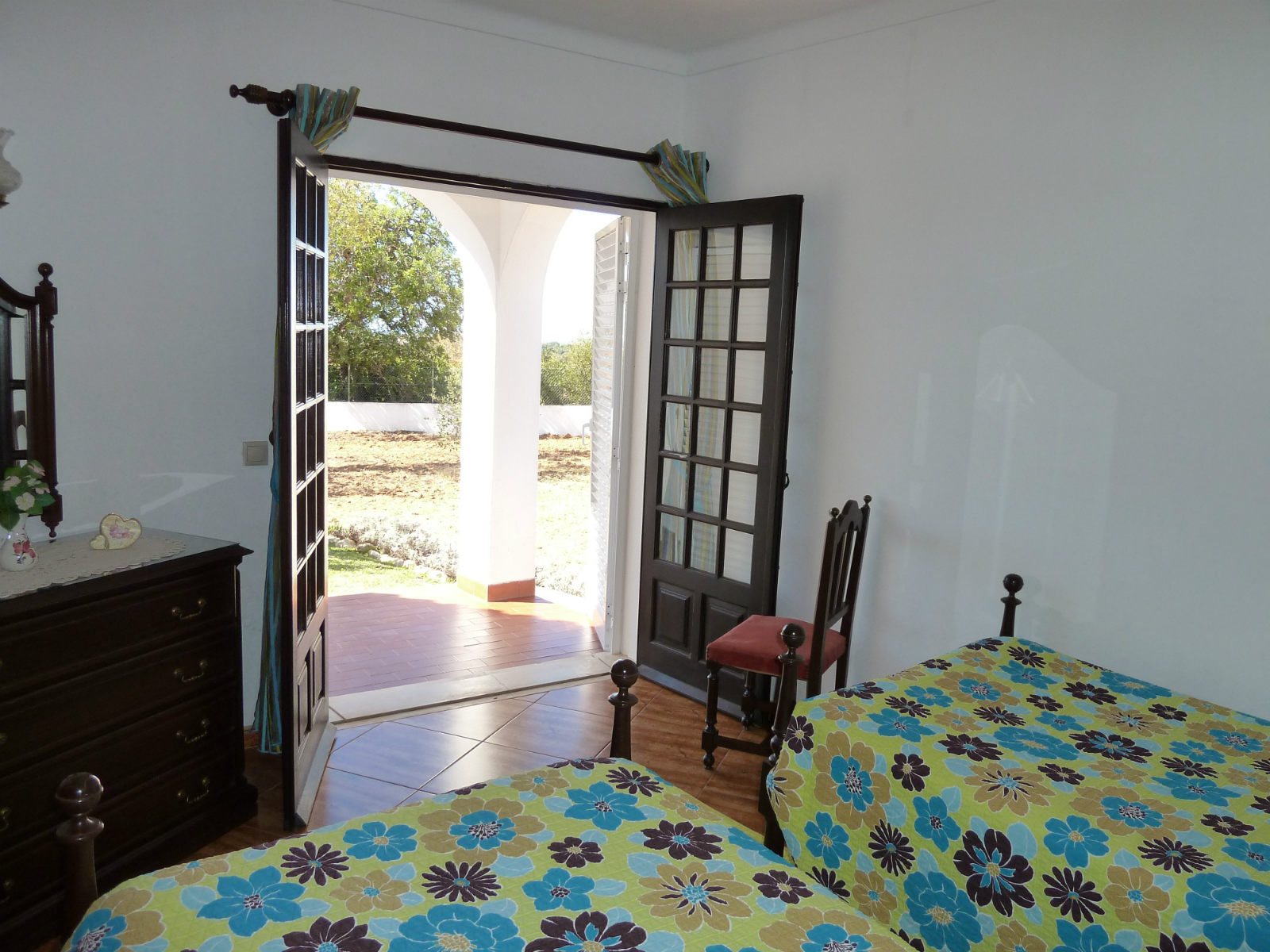 Twin room with partial sea views, doors to terrace
