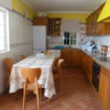 The light and bright kitchen, has double windows and doors to terrace & lounge.