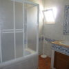 Full bathroom on the 1st floor located in the middle of both bedrooms.