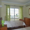 1st floor a/c twinbedroom with double doors to private balcony overlooking pool