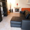 Cosy lounge with Cable TV with many channels, overlooking pool and terrace.