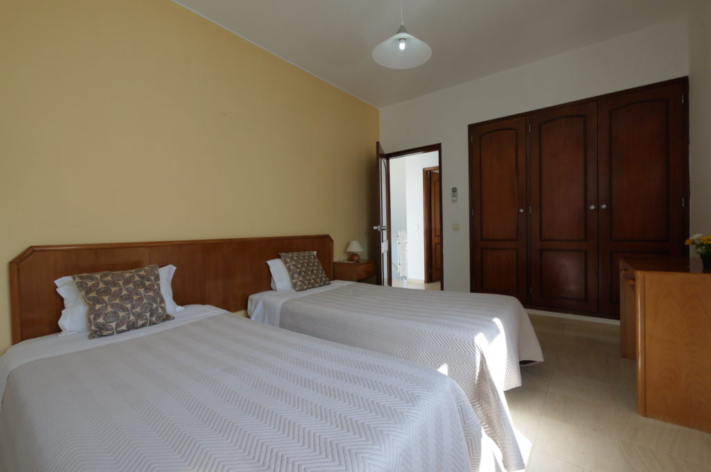 1st floor Air Conditioning Bedroom with a double bed & twin bed with built-in wardrobe.