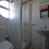 Blue bedroom private bathroom.