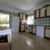 Very spacious fully equipped kitchen with door to side garden & built-in BBQ.
