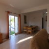 Spacious dining with extendable table with doors to kitchen, pool, terrace & garden from dining area.