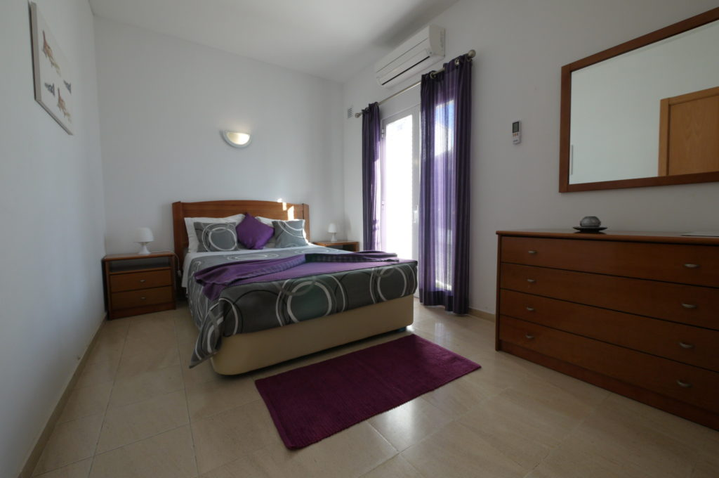 Air Conditioning ground floor double bedroom with double doors to side terrace.