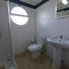 Ground floor fully tiled bathroom with walk in shower, w.c & basin.