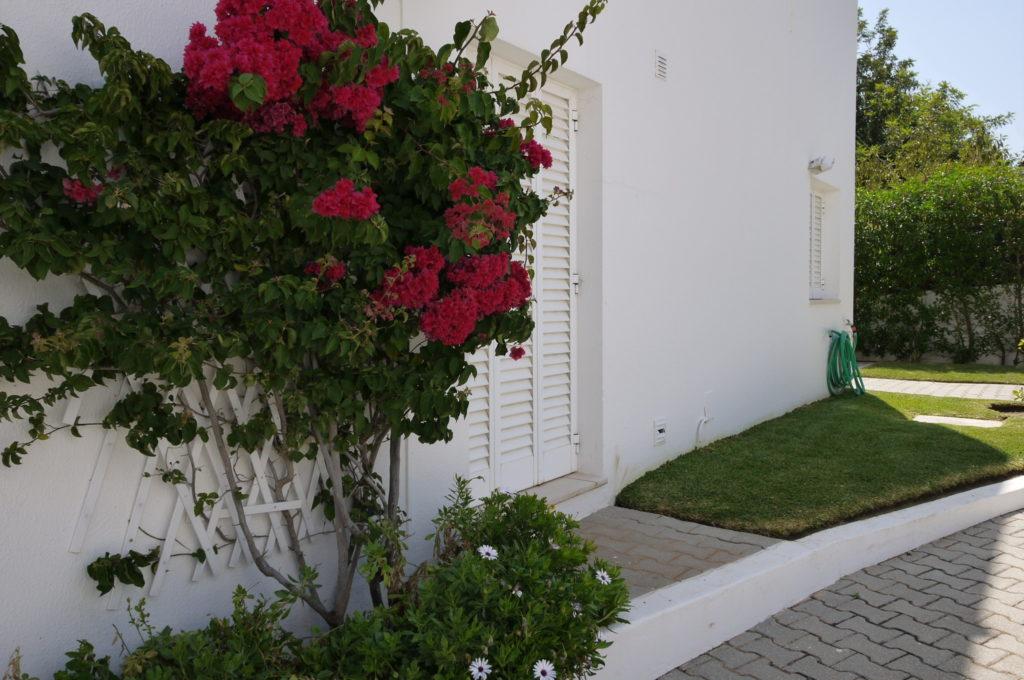 The ground floor A/C bedroom has double doors to side terrace, BBQ & garden.
