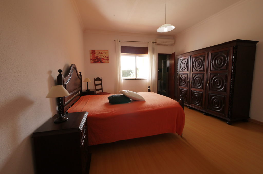 A/C, Double bedroom with private bathroom & double window with views to pool.