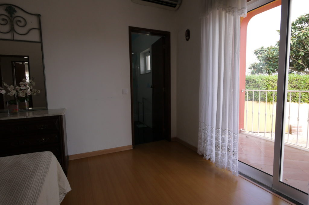 A/C Double bedroom with private bathroom and double doors to terrace.