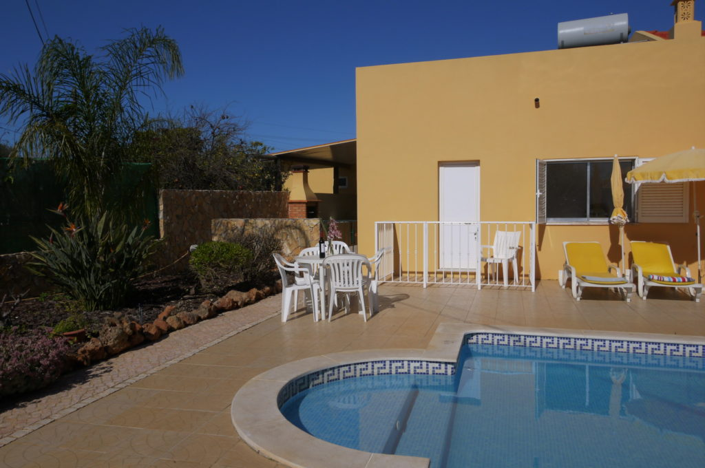 Wide walk in steps to pool, large BBQ with covered area, pool side table & chairs and more for you to enjoy.