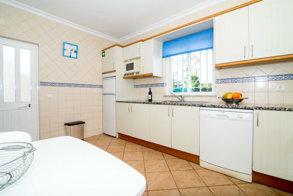 The fully equipped kitchen also has table & chairs & door to pool.