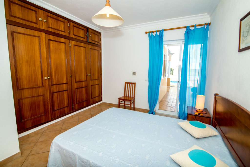G/Floor double bedroom with private bathroom, with doors to pool & terrace.