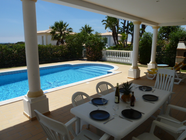 Estrelicia's sunny, south facing pool and partly covered terrace with sea views.