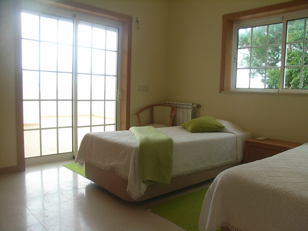 1st floor en-suite lime bedroom with double doors to terrace with sea views...