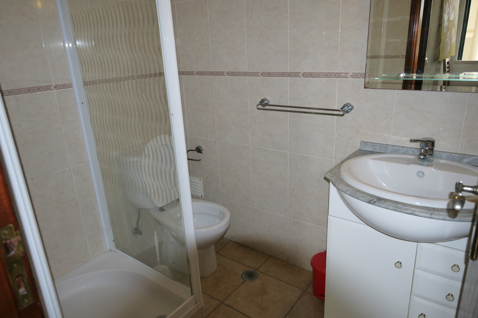 Ground floor, fully tilled bathroom has a walk in shower, basin, mirror & WC.