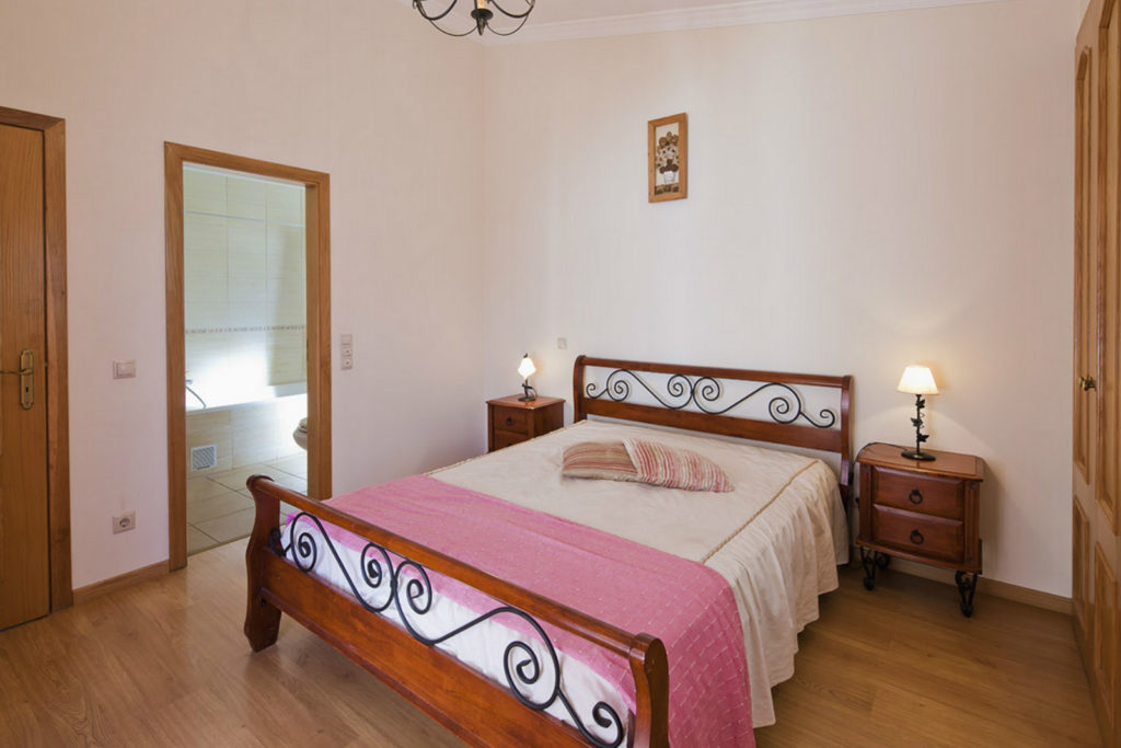 Double bedroom with bathroom overlooking pool  with double doors to pool terrace