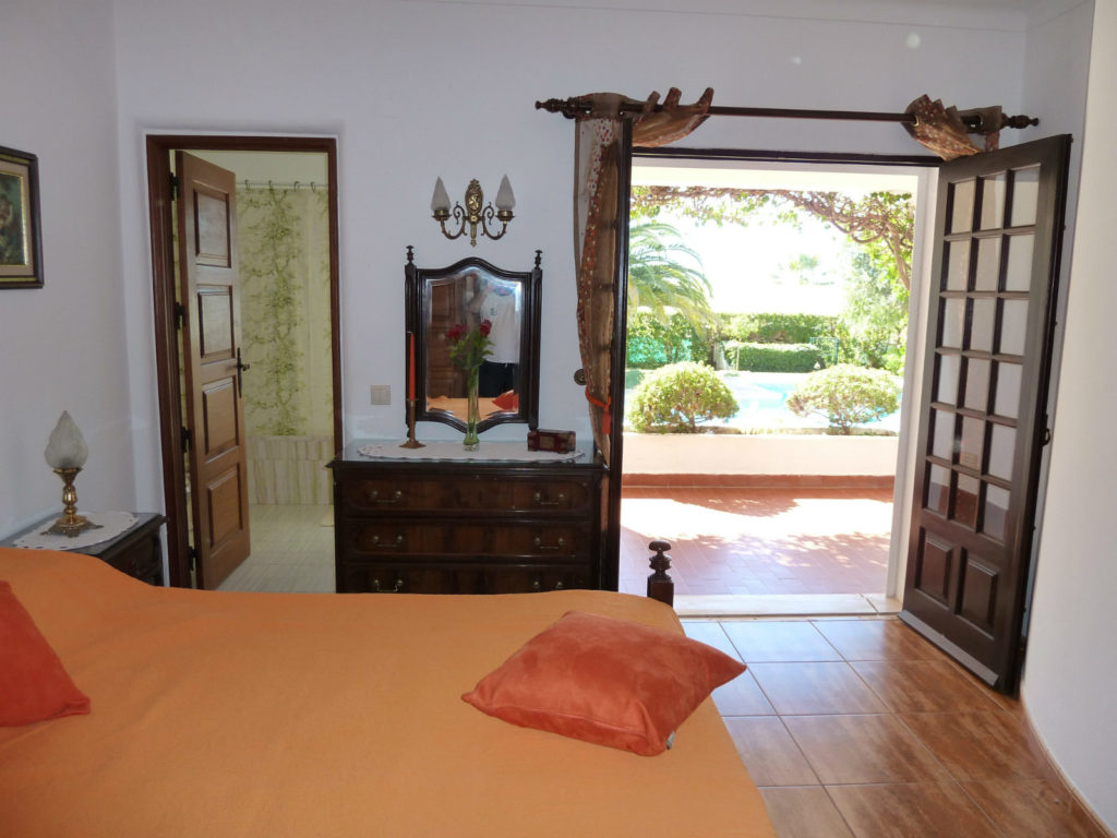 Master, en-suite double bedroom, with doors pool