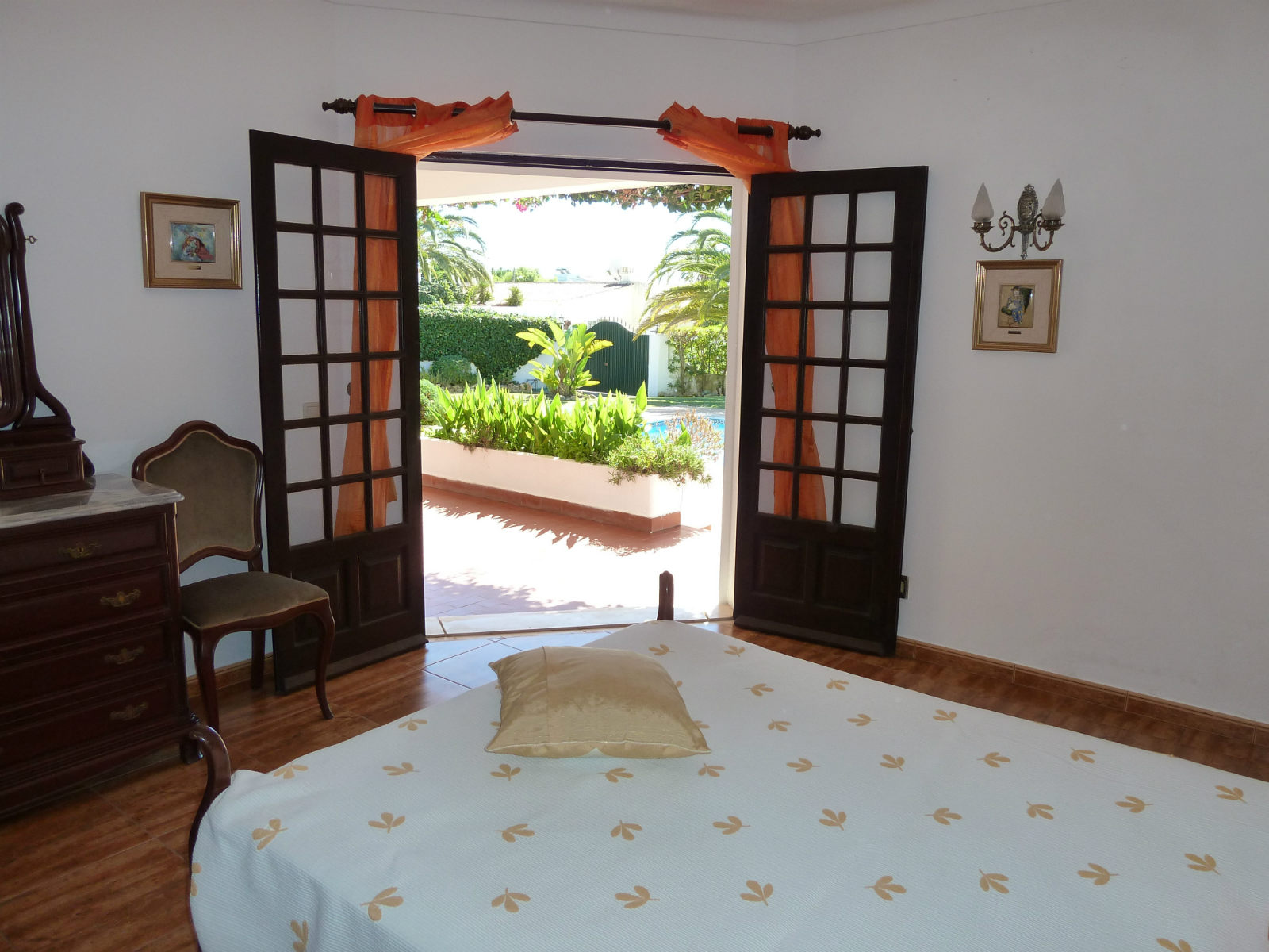 Double bedroom with doors to terrace & pool