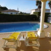Villa Estrelicia spacious terrace  with room for everyone, sunbeds & 2 large tables with chairs.