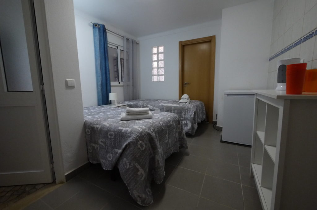 Villa extension twin bedroom with private bathroom.
