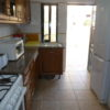 Fully equipped, full kitchen with door to BBQ, terrace, pool & lounge/dinner.