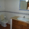 Attractive tilled, floor to ceiling ground floor  bathroom with walk in shower.