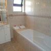 First floor, tilled, full master bathroom with bath, hand shower, basin & w.c.