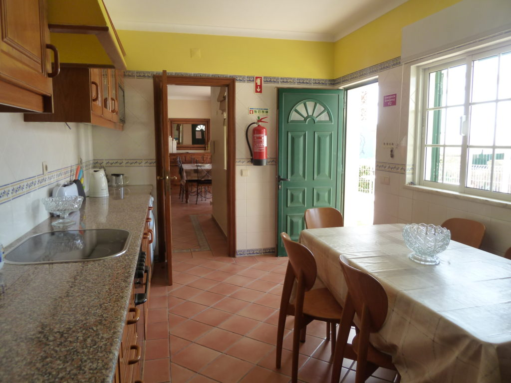Fully equipped spacious kitchen, complete with breakfast table overlooking pool.