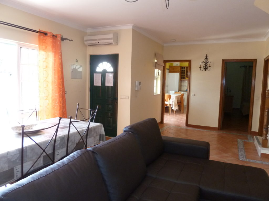 Air Conditioning Lounge/dinner with doors to terrace, kitchen and bedroom.