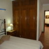 Ground floor a/c bedroom with double bed, built in wardrobes, bedside cabinets.