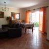 Very spacious, colourful & comfortable lounge with sofas and dining room.