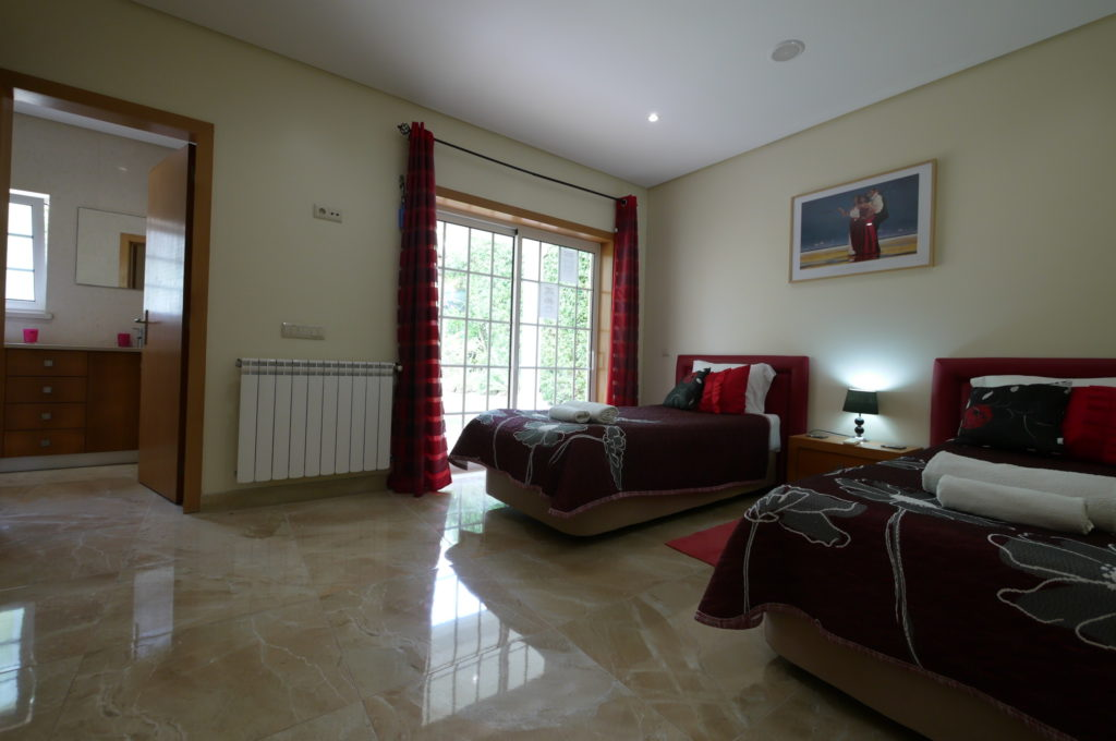 Ground floor twin bedroom with price bathroom & terrace.