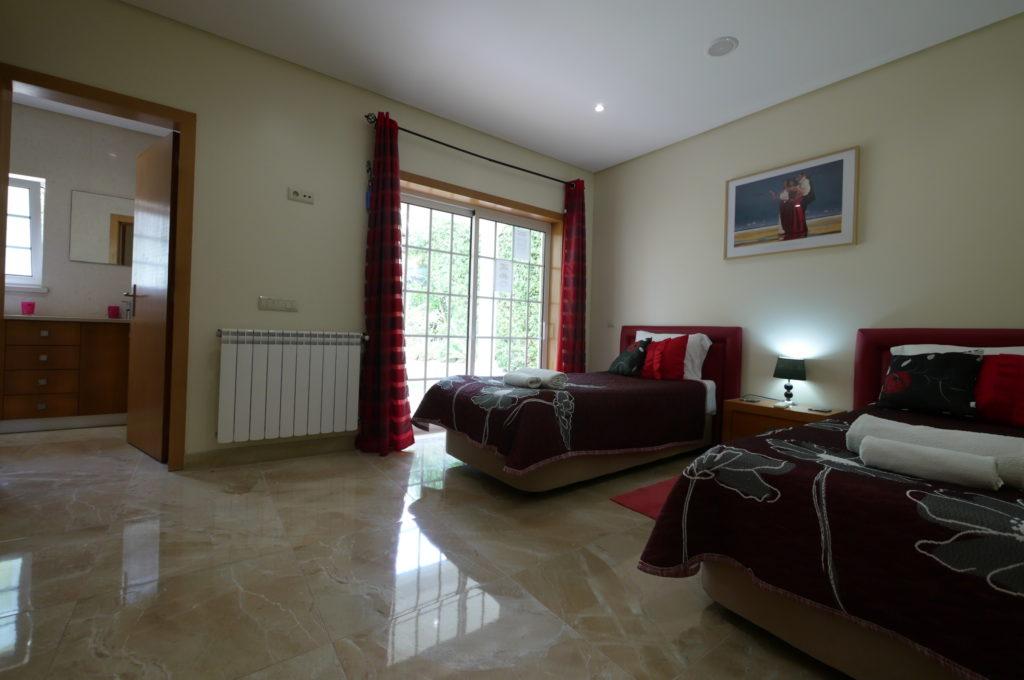 Ground floor twin bedroom with price bathroom & terrace.