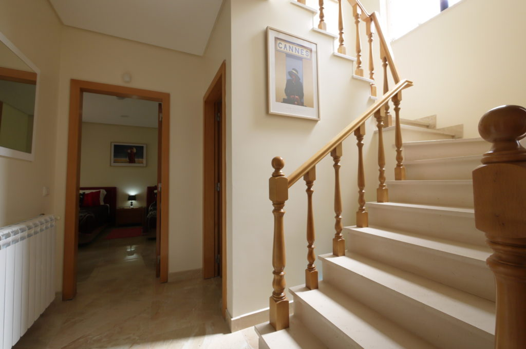 Entrance hall with Red/Black twin room, with steps to 1st floor bedrooms.