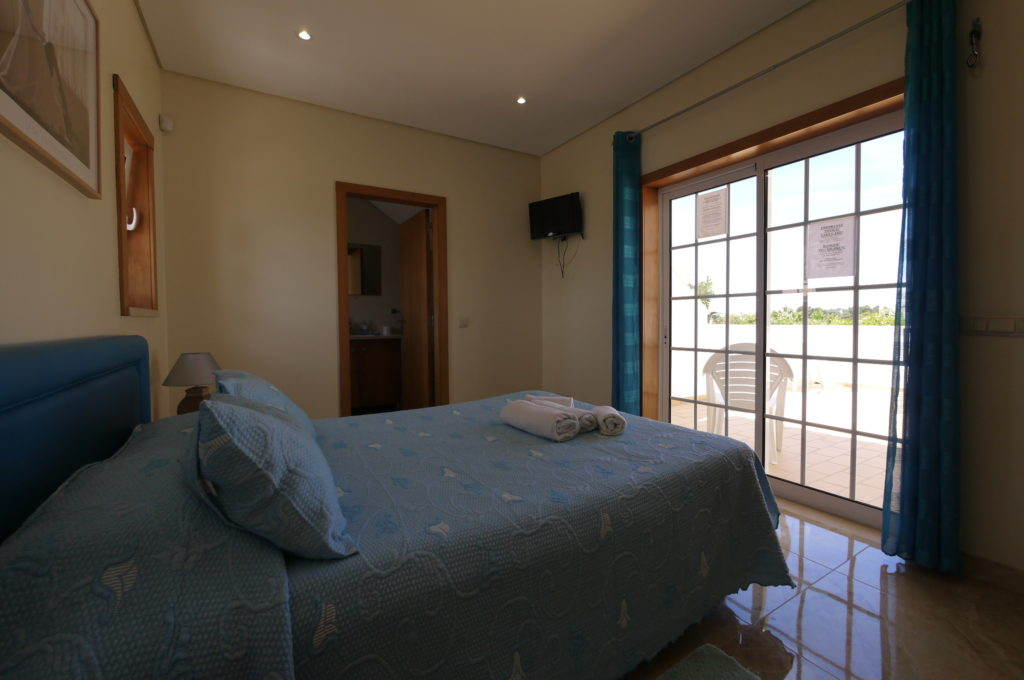 First floor double bedroom with private bathroom & terrace with sea views.