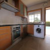 Fully equipped kitchen overlooking pool, gardens & sea views.