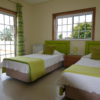 A/C Lime twin bedroom with Garden & Sea Views with double doors to terrace.